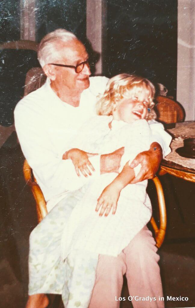 Grandfather holding Granddaughter in Chair